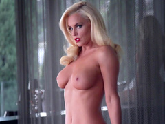 Blonde Jenny McCarthy poses naked at the balcony