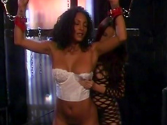Curly-haired ebony being dominated in BDSM video