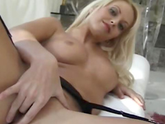 Little vibrator pleases girl in stockings