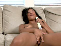 Ebony Emy is drilling her tight shaved puss