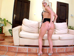 Glamour blonde Cindy Dollar posing on high heels