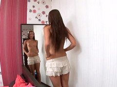 Smiling babe Asya is playing with her lovely pussy