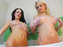 Two sensual cuties are playing with nice boobies