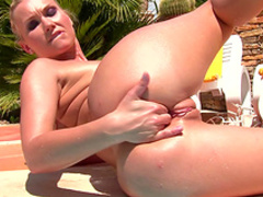 Blonde Michelle is masturbating at the pool