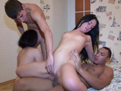 Two hot brunettes are fucking with black dick
