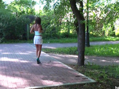 Brunette in white dress shows off her ass in the public