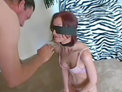 Blindfolded redhead Kati taking part in a threesome sex