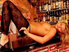 Blonde Denisa D is lying on the bar stand