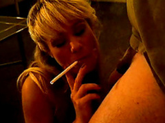 Slender blonde is smoking and sucking a dick