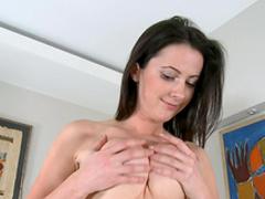Slender brunette Orlenda poses naked in the bedroom