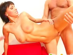 Tanned brunette with big tits gets two cumshots