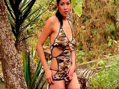 Slender Latina takes off her nice dress in the forest