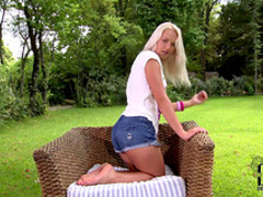 Busty blonde Evelyn takes off her pink panties