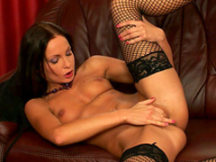 Brunette Lauryn May demonstrates her shaved pussy