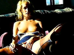 Blonde is lying on sofa and masturbating her puss