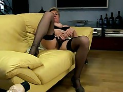 Mature Blonde Plays with Dildos and Masturbates