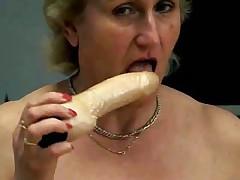 Mature Blonde Plays with Dildos and Masturbates