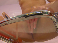 Sweet brunette Presley Dawson is sitting on the transparent chair