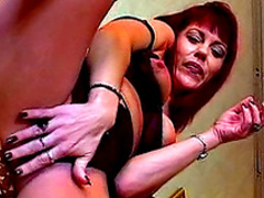 Redhead mature with cute face is smoking