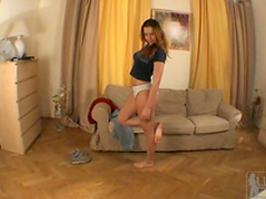 Brunette Karol B demonstrates her long legs