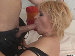 Short-haired milf masturbates and fucks in her face