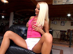 Tanned blonde is playing with a strapon