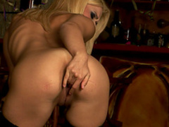 Delicious blonde in stockings playing solo
