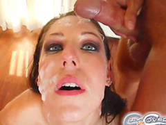 Hot babe gets four dicks in her wide mouth