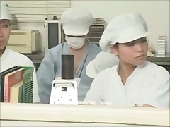 Female working at the condom factory