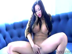 Dark-haired is masturbating on sofa