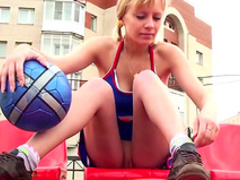 Sporty babe in playing with a ball