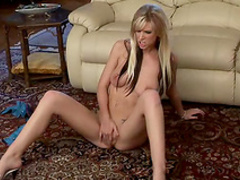 Slender blonde Brooke Banner is playing with her puss