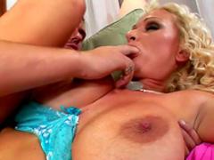 Curly pornstar Sharon Pink gives a blowjob
