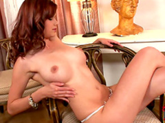 Curly-haired redhead Kami is playing with her boobies