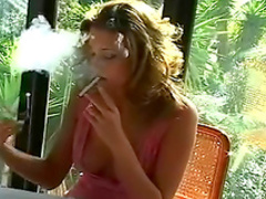 Sensual blonde is smoking a cigarette so sexy