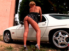 Zuzana Z is posing naked next to the car