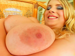 Glamorous blonde pokes her trimmed pussy