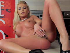 Fake-tit blonde is sitting on her red dildo