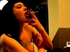 Sweet brunette with small tits is smoking