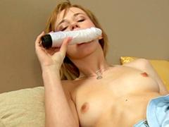 Brunette Deina is sucking her lovely dildo