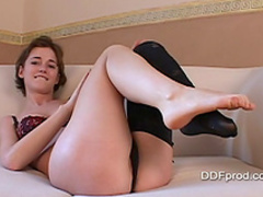 Teen brunette Amy F is demonstrating her short hair and stockings