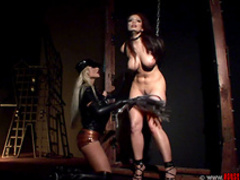 Aria Giovanni and latex Kassey Krystal are spanking each other