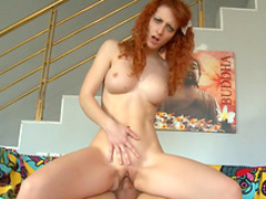 Busty redhead has hardcore sex on the sofa