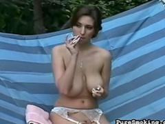 Cute beauty is smoking a hot cigarette