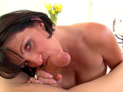Enchanting brunette milf gives blowjob and titjob