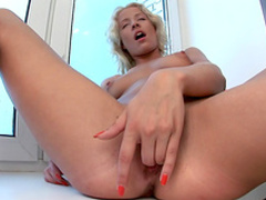 Blonde with short hairs is touching her cute snatch