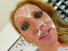 Spicy blonde is getting her face covered with sperm