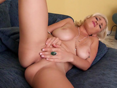 Curly blonde takes off her bra with panties