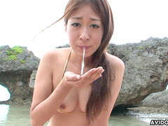 Sensual babe Risa Misaki is tasting dick in front sea