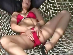 Nice Asian babe is sucking a long dildo